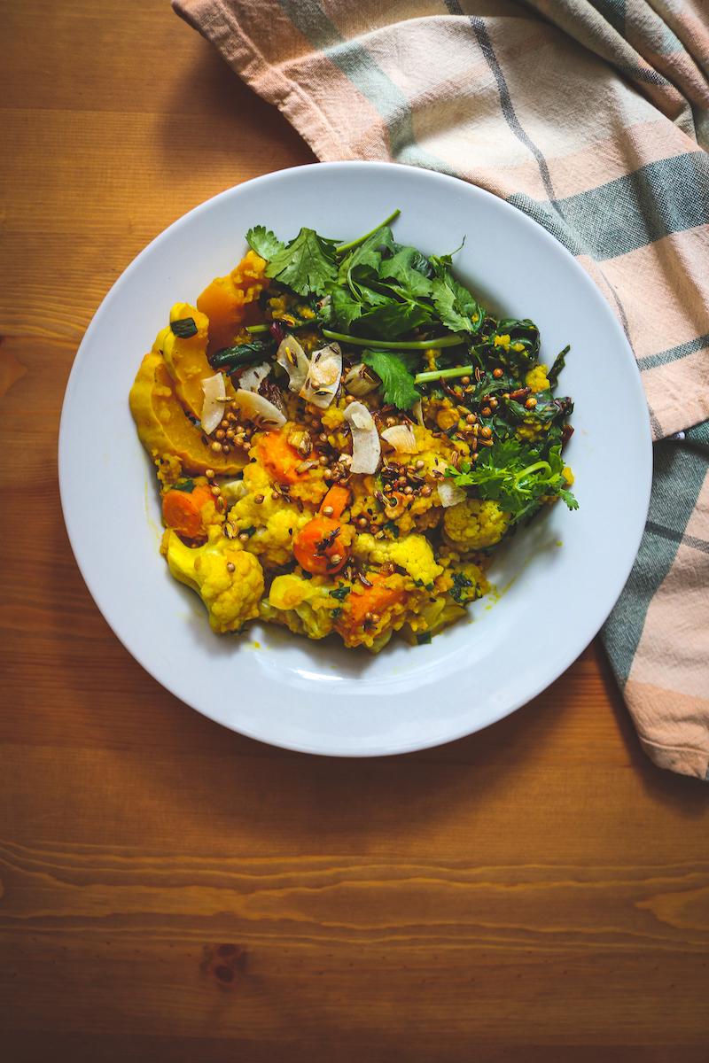 Fall Kitchari with Cauliflower, Squash, Carrots, and Beet Greens